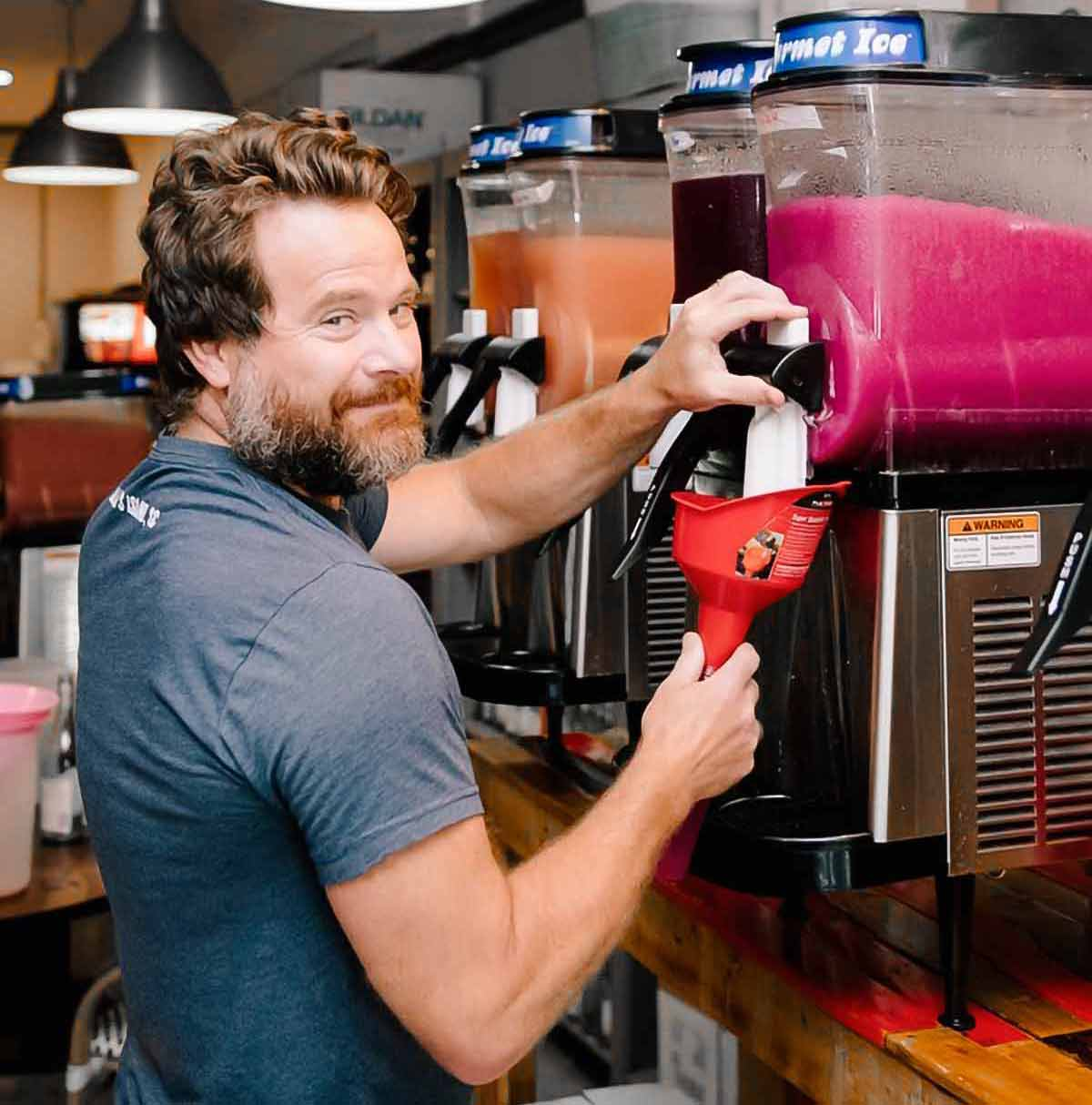 An image of Jess Patterson at a Frosé machine for the podcast, Talking With My Mouth Full, Ep. 30: Jess Patterson: Frosé King