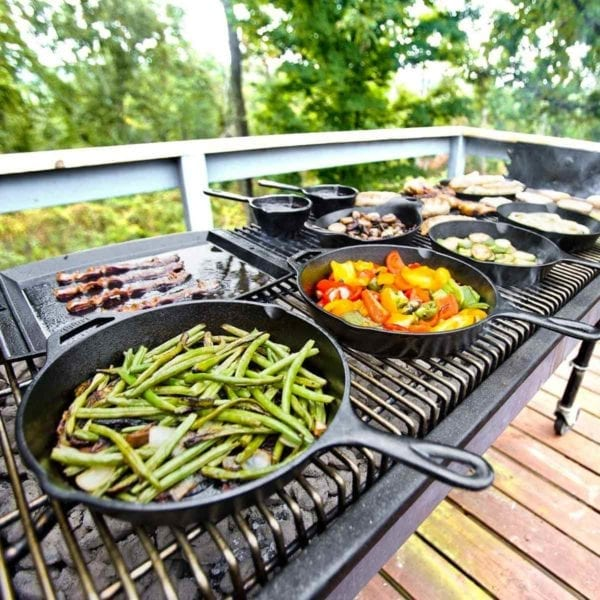 Lodge Pre-Seasoned Cast Iron Skillet With Assist Handle on a grill.