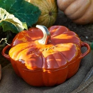 Staub Cast Iron 3.5qt. Pumpkin Cocotte in a pumpkin patch.