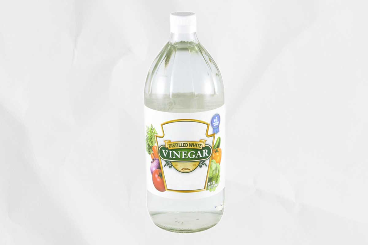 Two bottles of white vinegar, which can be used if you're wondering how do I clean my grill?