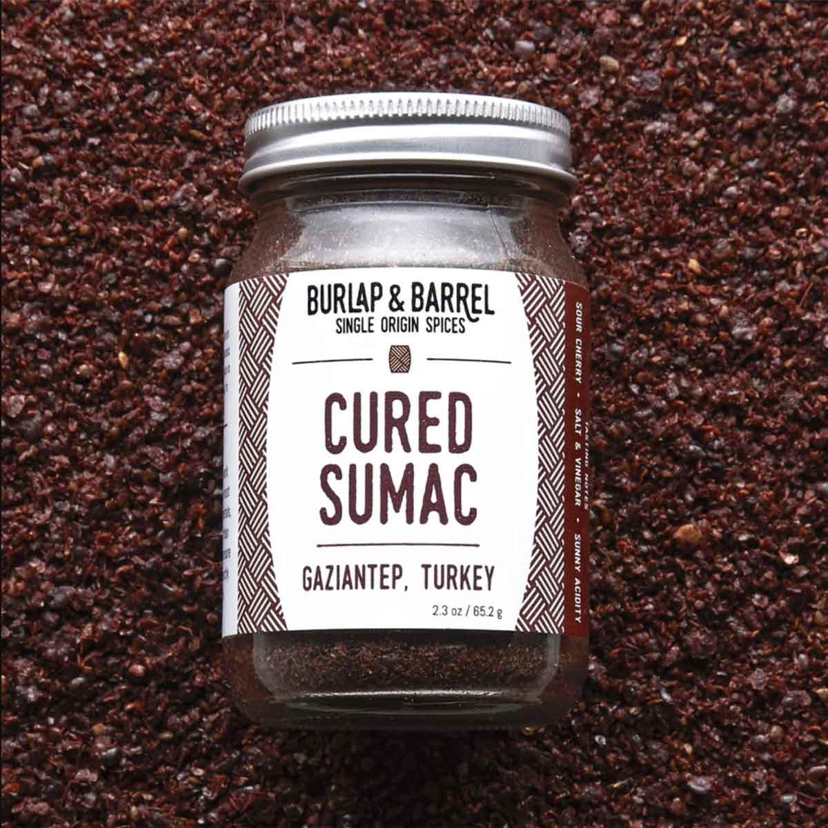 Cured Sumac in jar on bed of sumac.