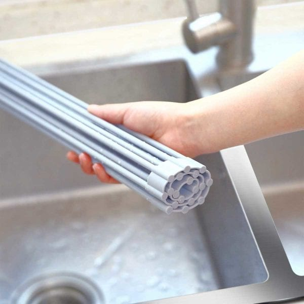 Foldable Multi-Use Drying Mat rolled up in hand.