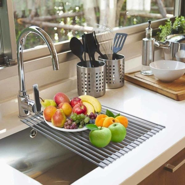 Foldable Multi-Use Drying Mat with fruit on sink.