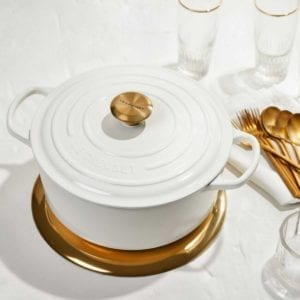 Gold knob and gold flatware.