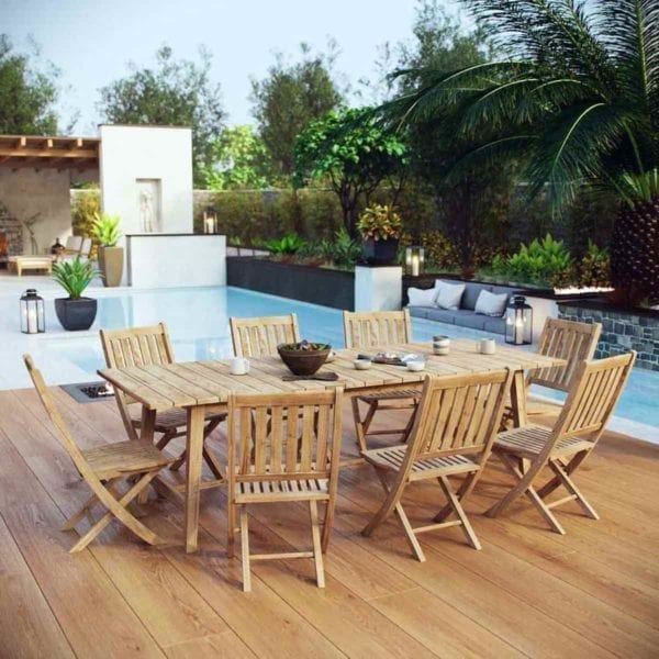 Marina Outdoor Patio Teak Dining Set by a pool.