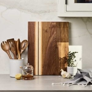 Motley American Maple Cutting Board on a kitchen counter for display