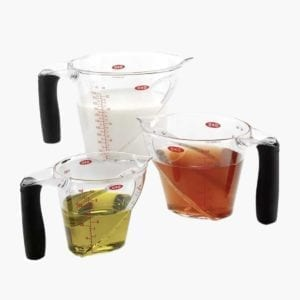 3 measuring cups filled with liquid
