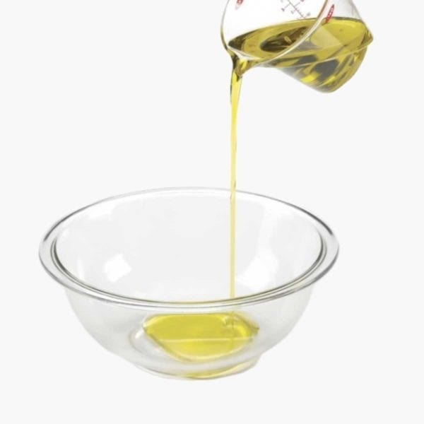 Pouring olive oil into a bowl.