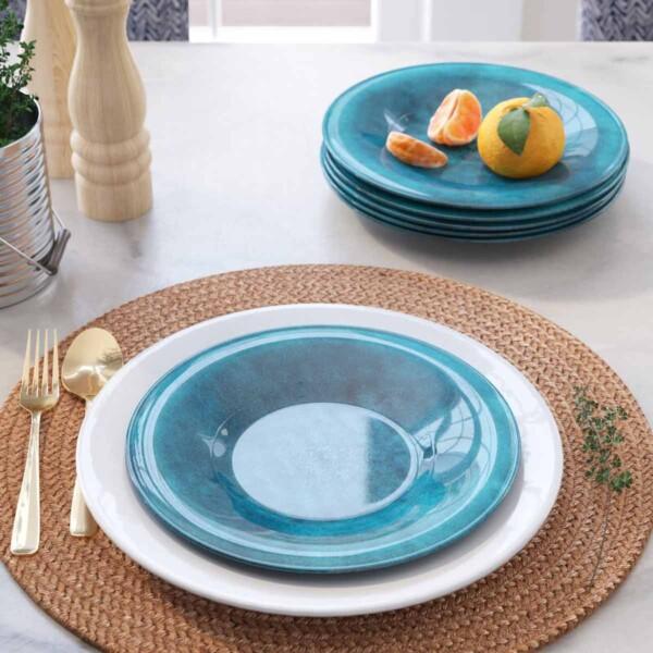 Blue Seth Glaze Salad Plate on charger.