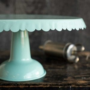 Tin Cake Stand on Dark Background