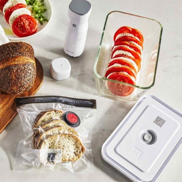 A photo of a Zwilling Fresh & Save container on counter with tomato mozzarella salad.