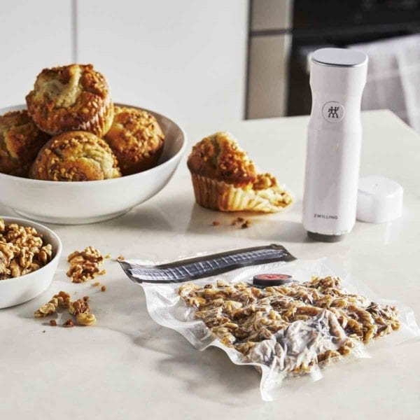 A photo of a Zwilling Fresh & Save vacuum bag on counter with walnuts.