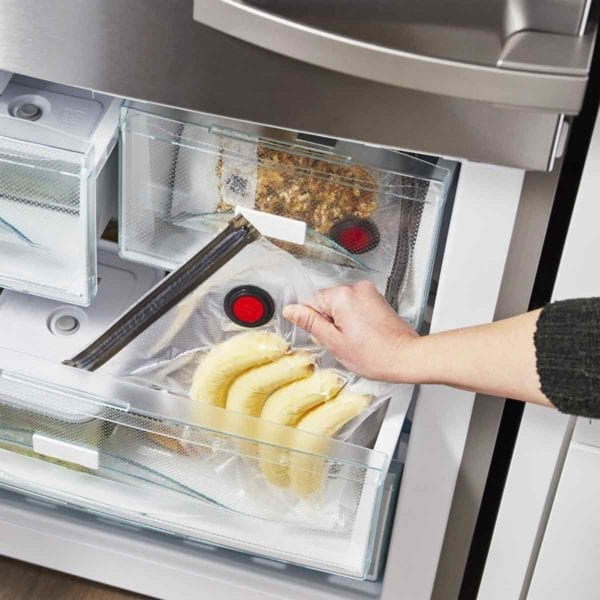 A photo of a Zwilling Fresh & Save vacuum bag in freezer with bananas.