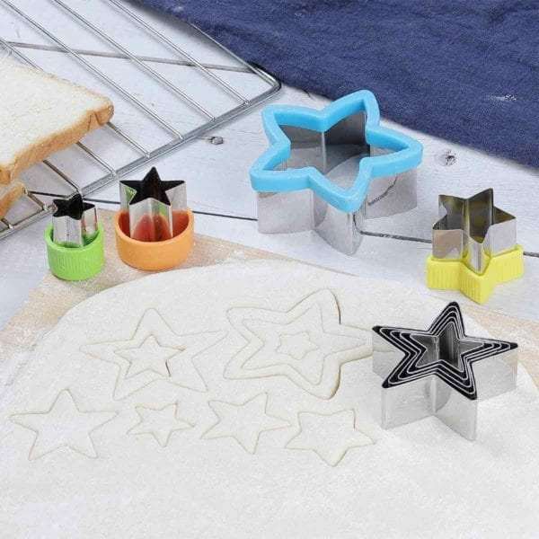 5 Pointed Star Cookie Cutter Set shown in use with rolled out cookie batter.