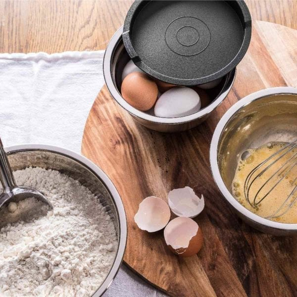Bellemain Non-Slip Mixing Bowls in use with eggs and flour.