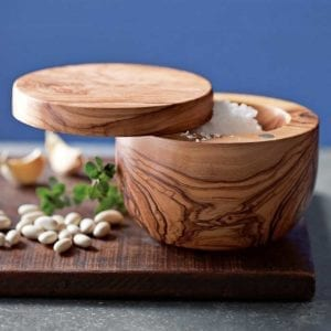 Berard Olive Wood Handcrafted Salt Keeper shown on wood cutting board with white beans and oregano.