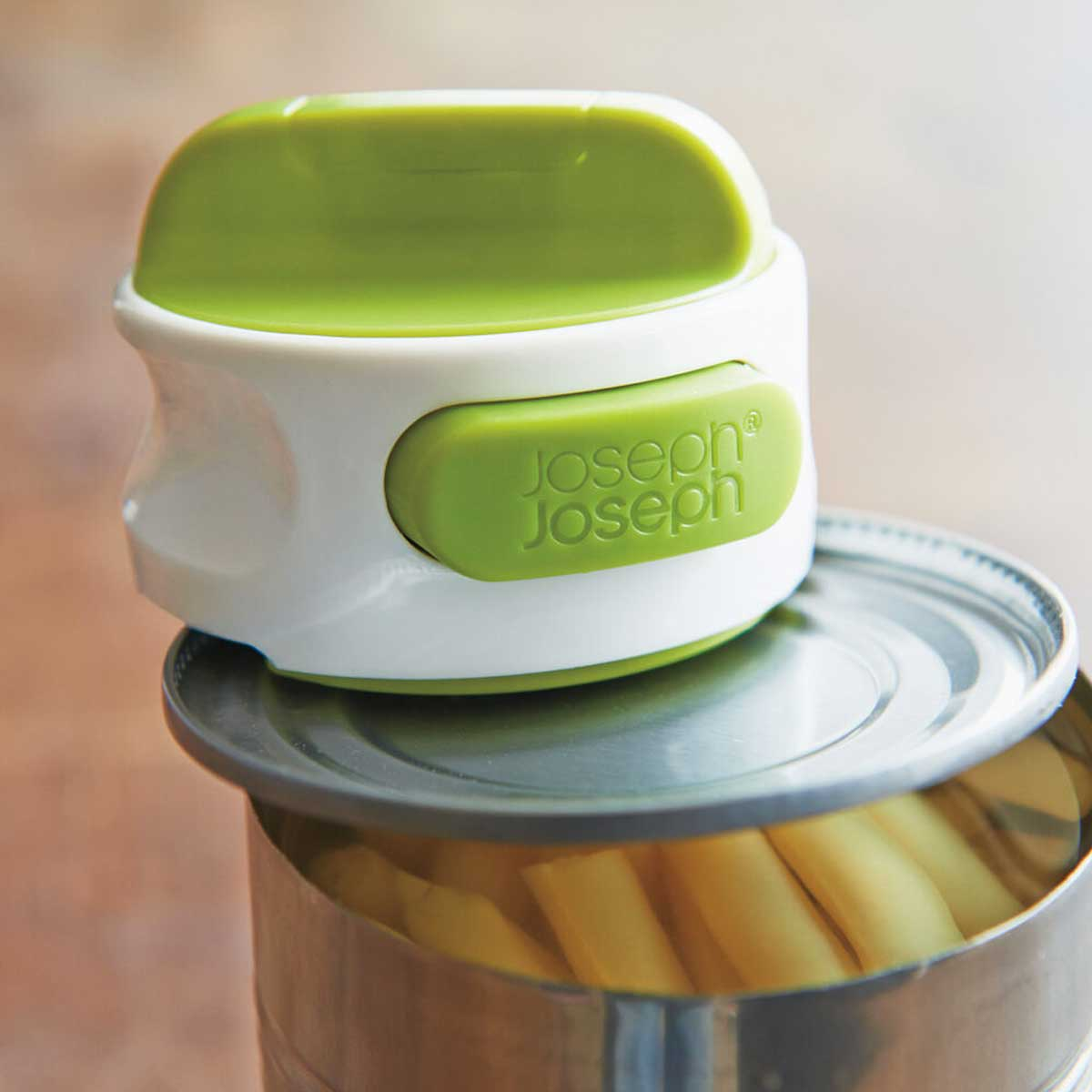 Can-Do Compact Can Opener in action on can of yellow beans.
