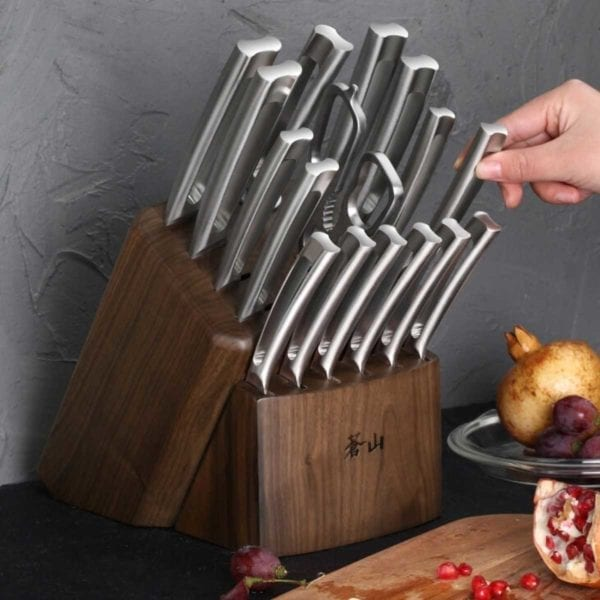 Hand grabbing a knife from Cangshan TN1 Series 17-Piece Knife Block Set.