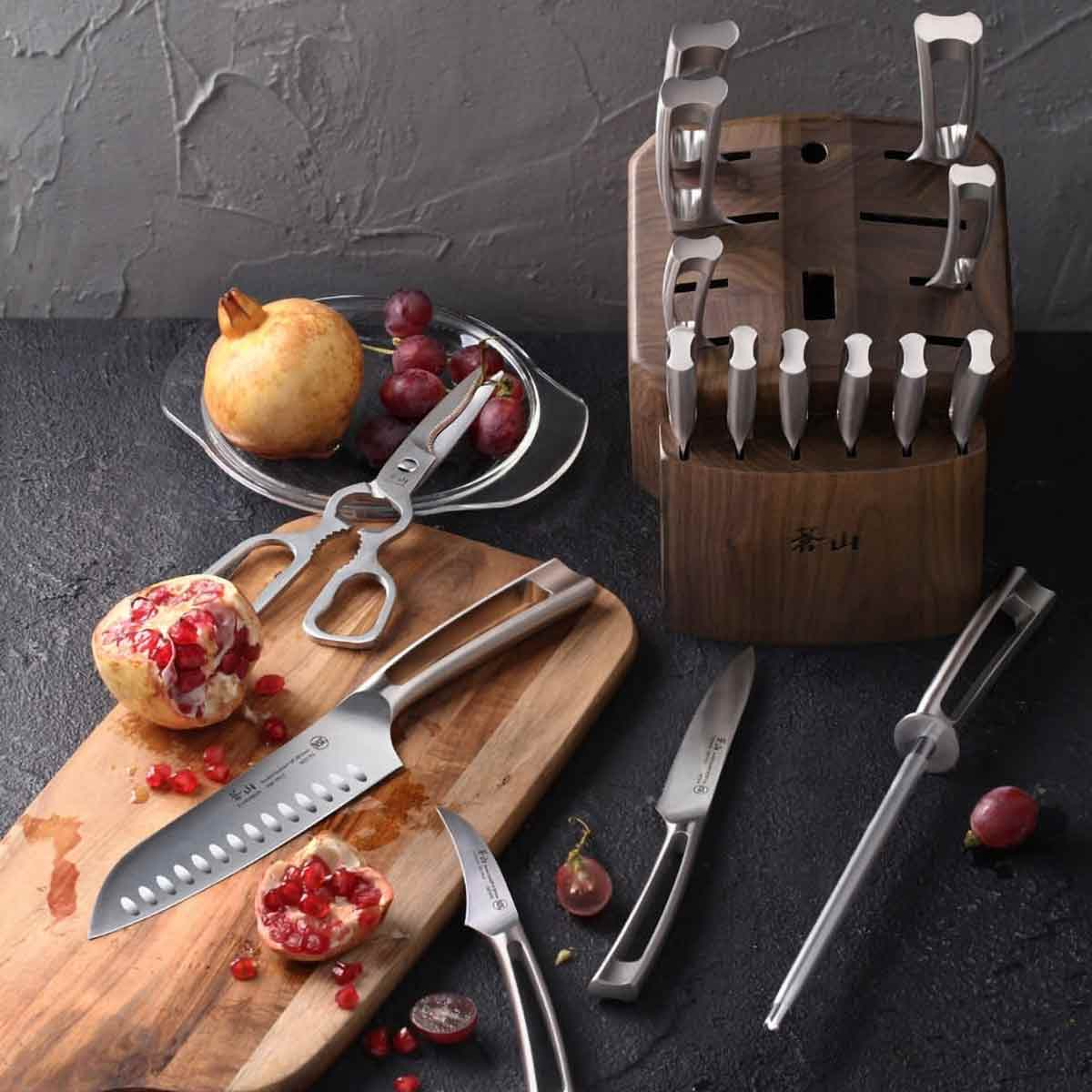 Cangshan TN1 Series 17-Piece Knife Block Set with grapes and pomegranate cut open.