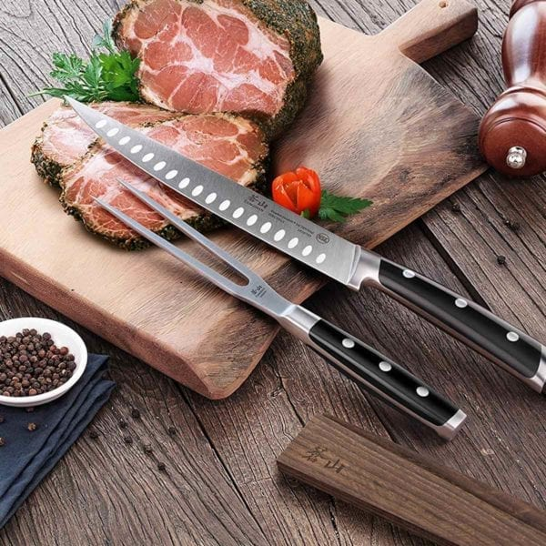 Cangshan TS Series 2 Piece Carving Set shown with roast beef.