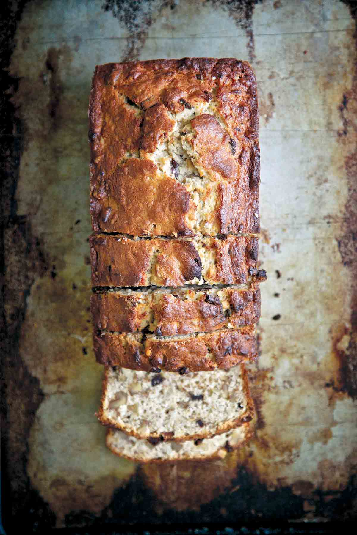A loaf of chocolate-bourbon banana bread with several slices cut off one end.Chocolate Bourbon-Spiked Banana Bread
