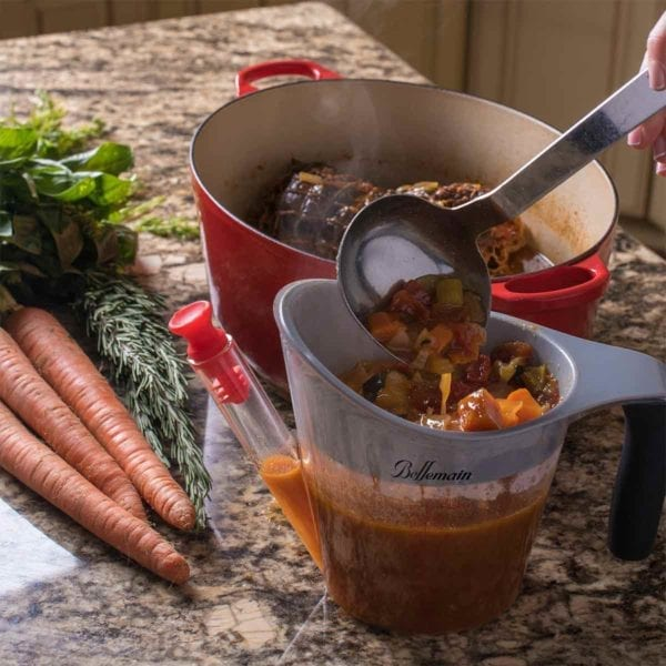 Fat Separator and Measuring Cup shown with carrots to the left.