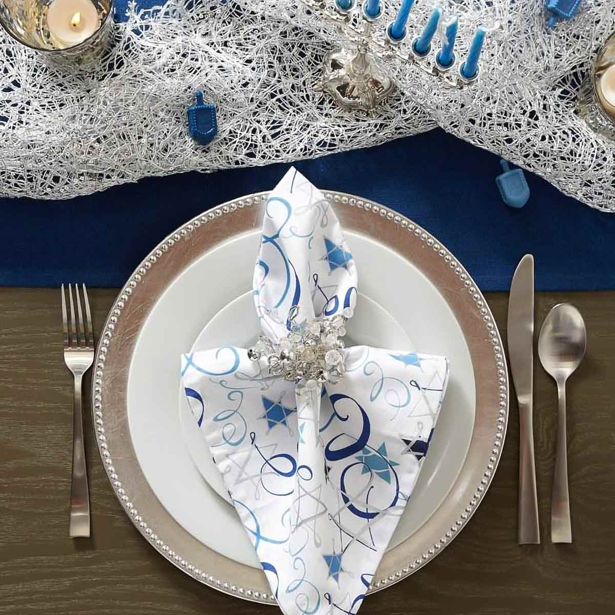 Hanukkah Swirls Printed Napkins on plate with silver and crystal napkin ring.