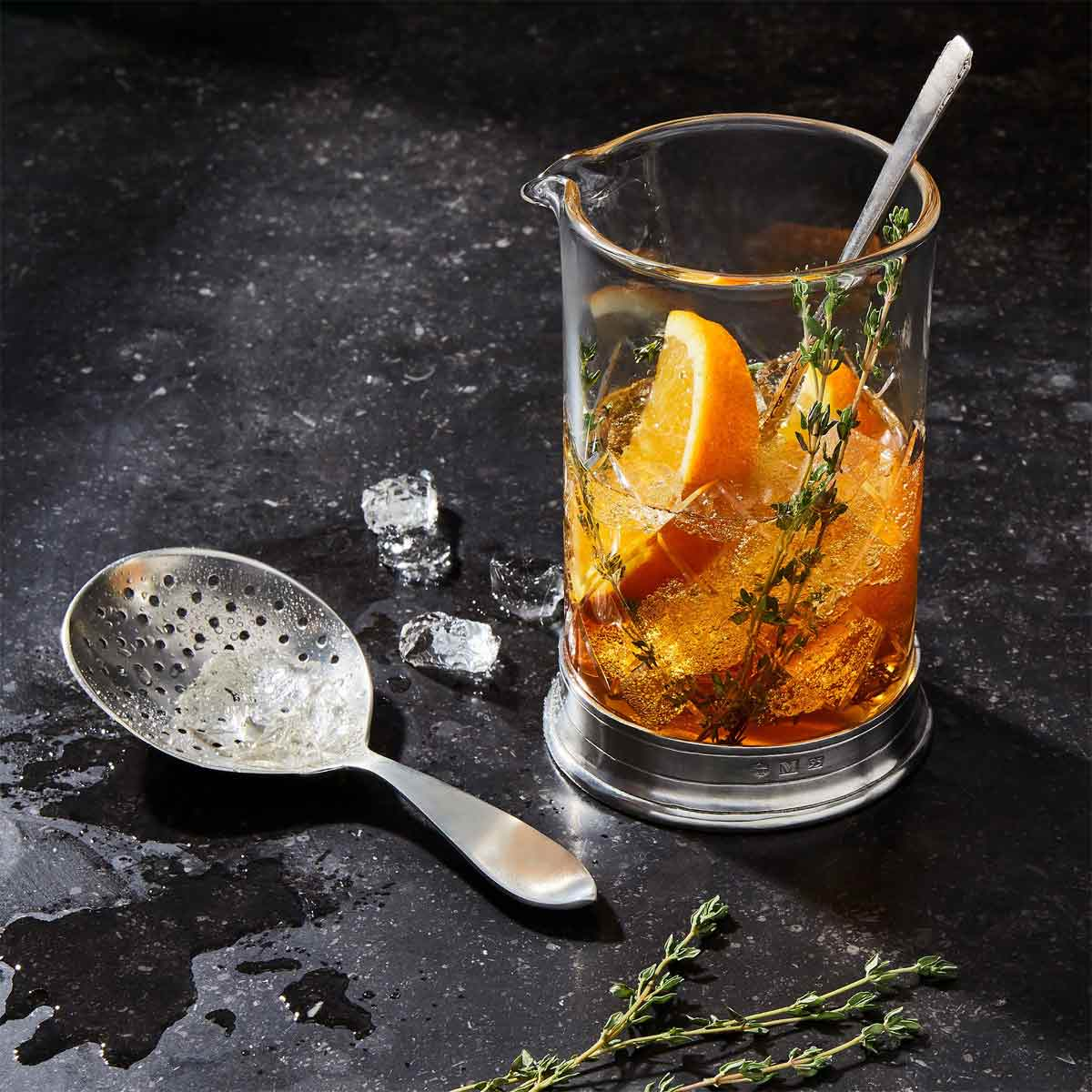 Match Cocktail Mixing Glass with thyme orange and bourbon.