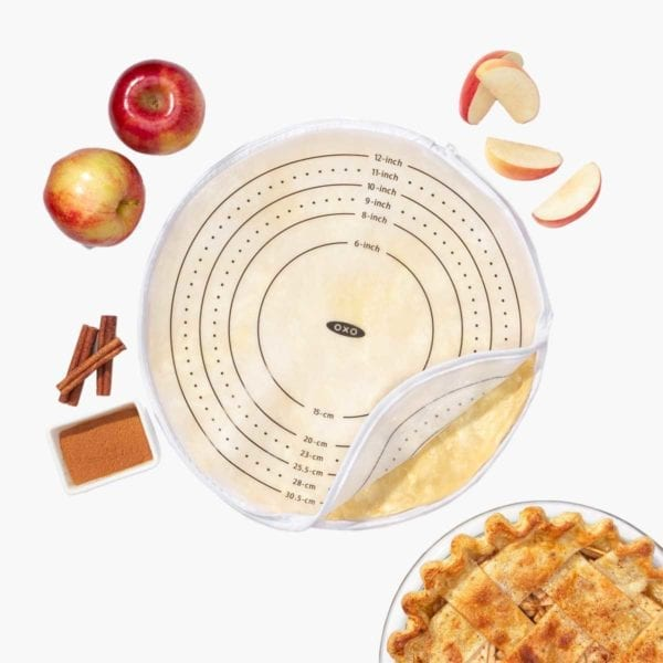OXO Good Grips Silicone Dough Rolling Bag pictured with apple pie in bottom right corner.