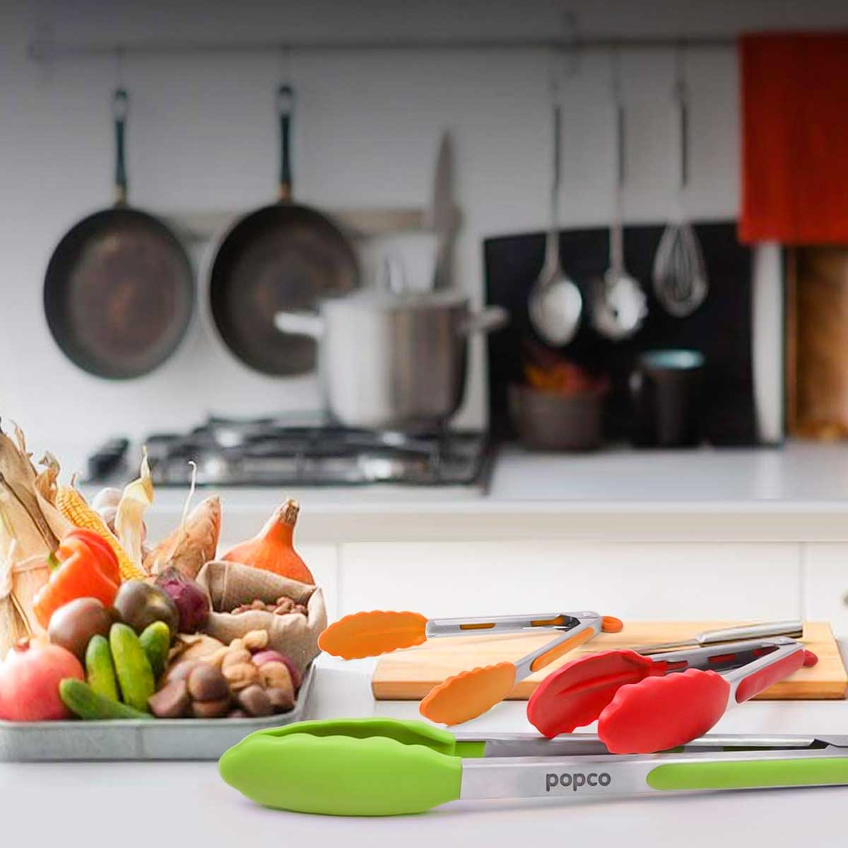 Popco Silicone Tipped Tongs on the counter red orange and green.