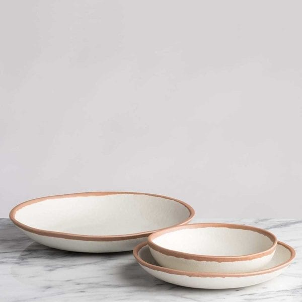 Q Squared Potter Collection Dinner Plate on marble counter.