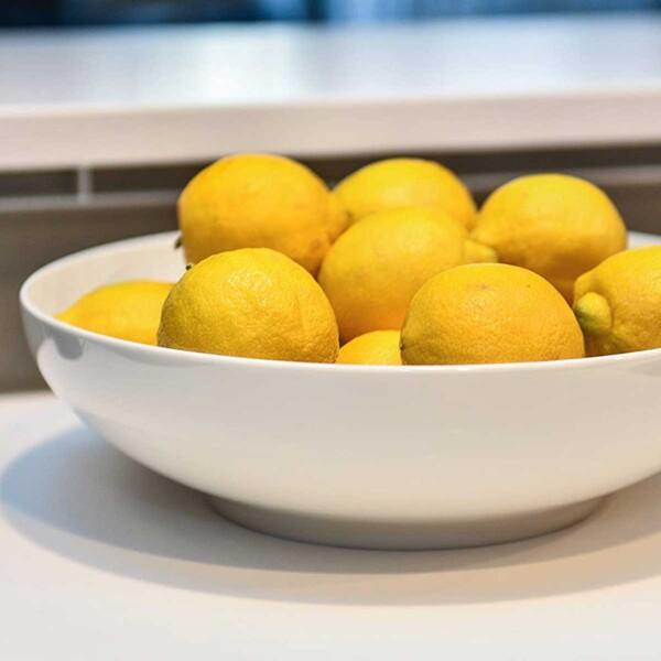 Red Vanilla White Dinnerware bowl with lemons.