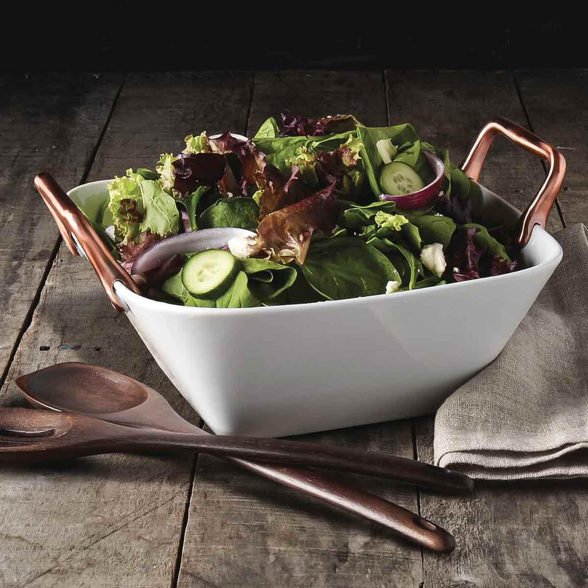 Romford Square Serving Bowl shown with salad on wood table with wood serving utensils.