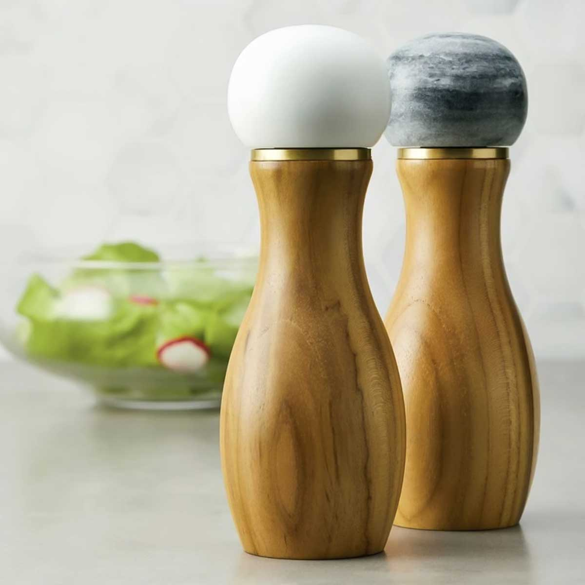 Salt and Pepper Grinders with Salad