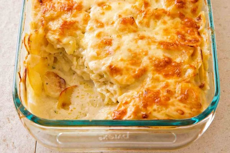 A glass baking dish filled with scalloped potatoes