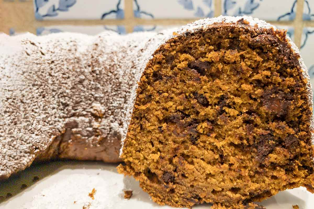 A spiced sweet potato bundt cake dusted with confectioners' sugar.