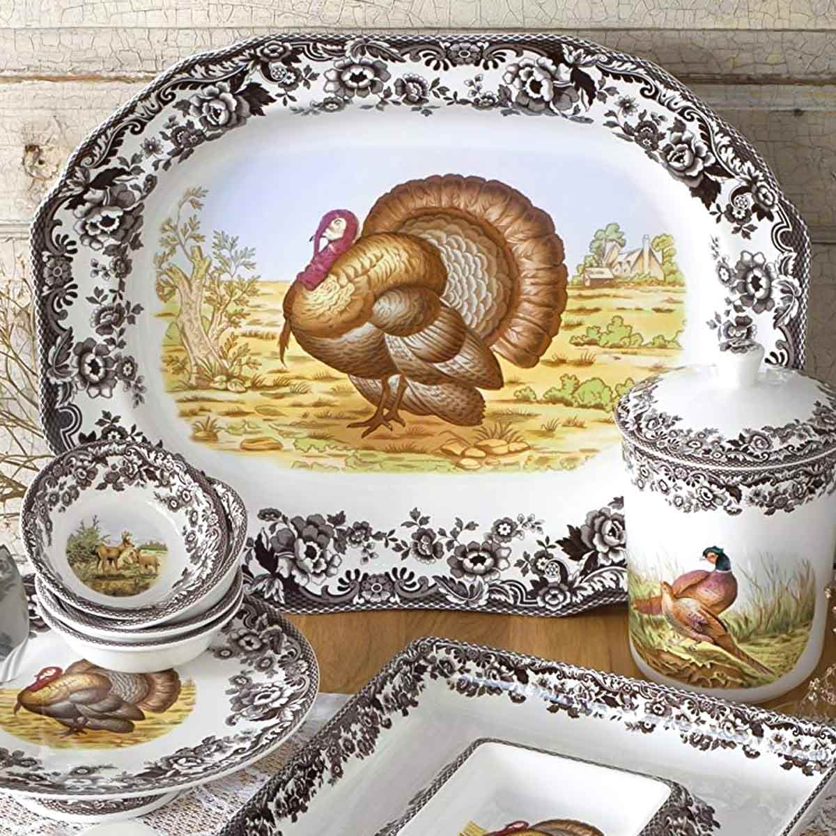 Spode Woodland Turkey Platter on wood table with other pieces.