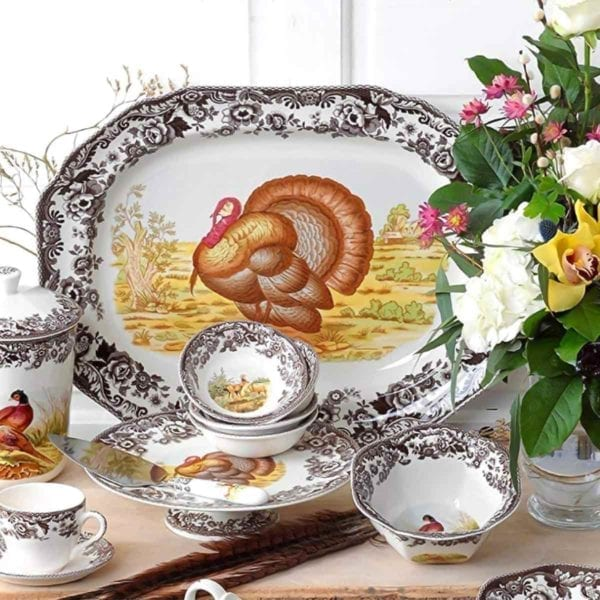 Spode Woodland Turkey Platter with flowers on table.