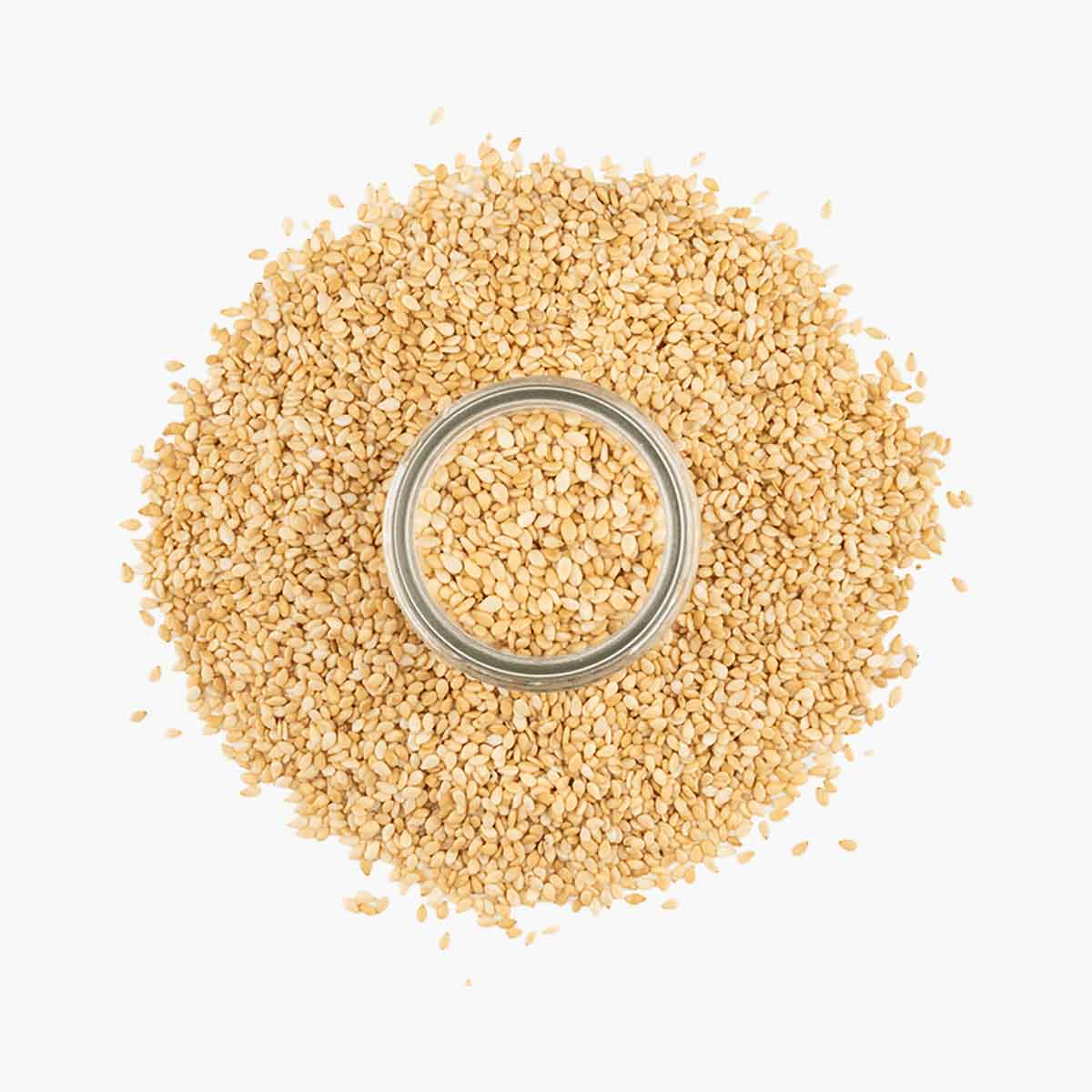 Large pile of Toasted Sesame Seeds on white background.