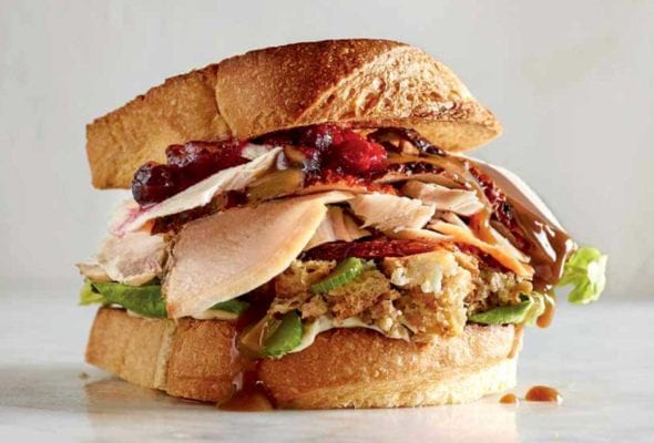 A turkey cranberry sandwich with stuffing on toasted bread.