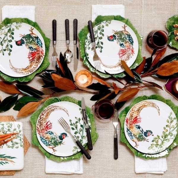 Four Vietri Fauna Salad Plate on green leaf chargers.