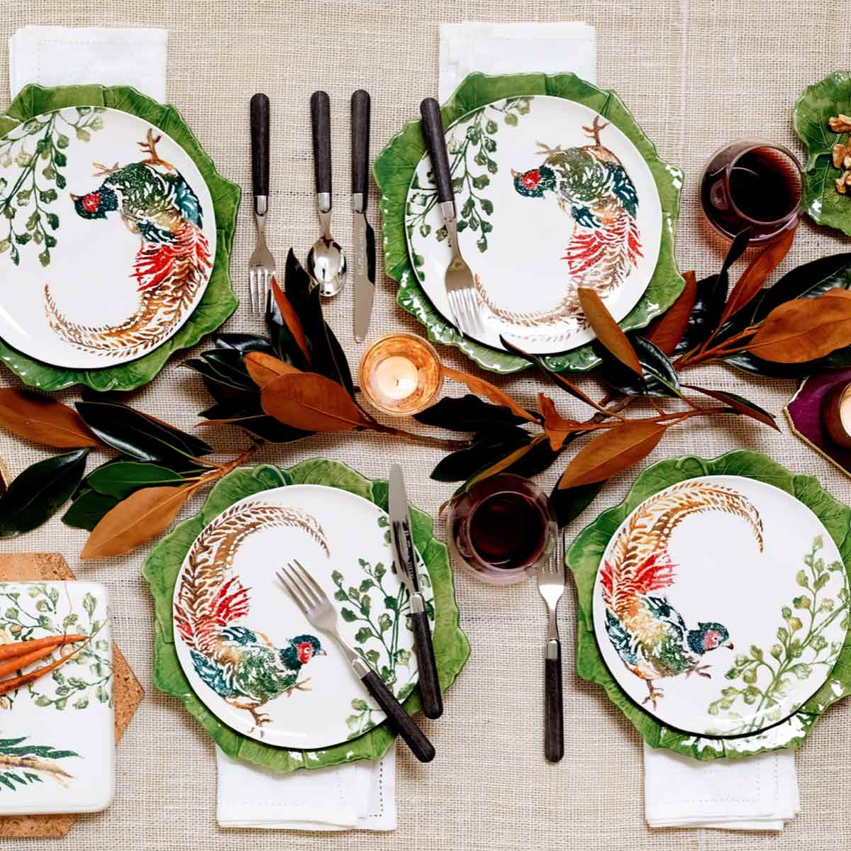 Four Vietri Fauna Salad Plate on green leaf chargers.