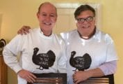 A photograph of David and the One in Thanksgiving t-shirts for the writing