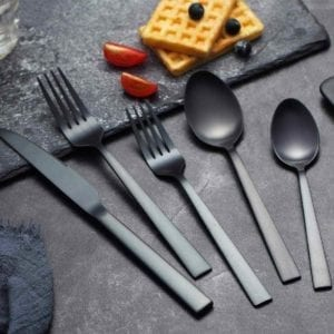 Titanium Flatware on table with waffles above.